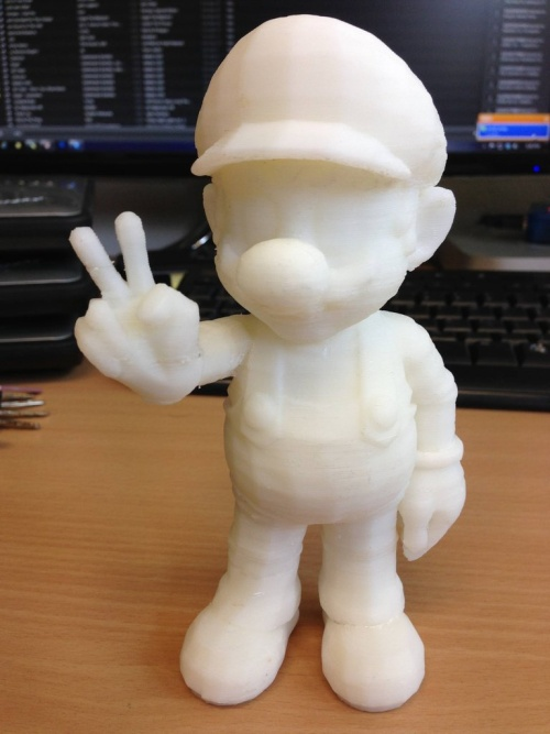 3D printed model of Mario right after printing