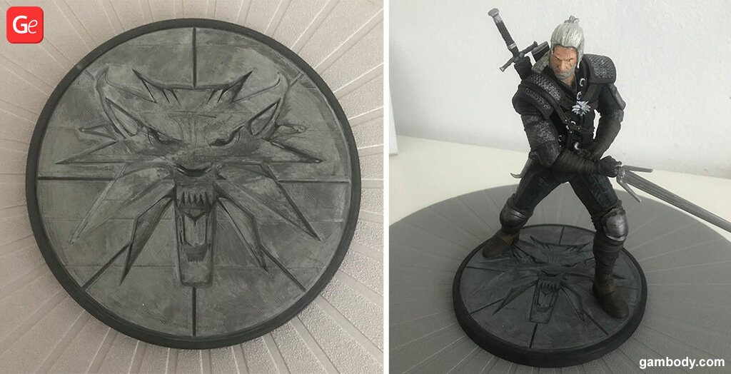 Witcher figurine on the base with wolf symbol