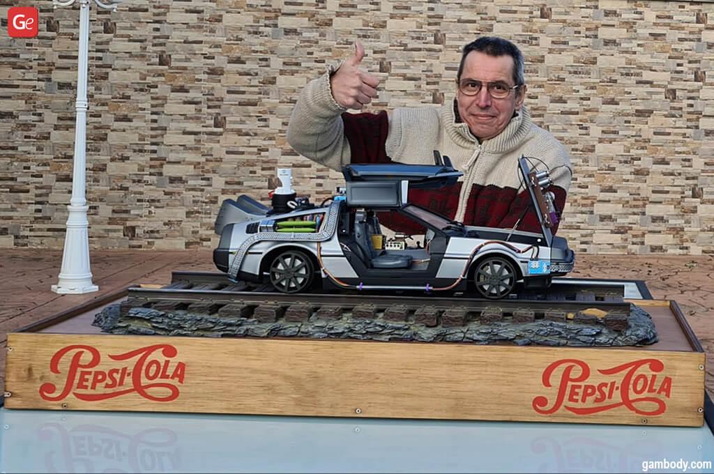Carlos Diaz with a 3D printed DeLorean car